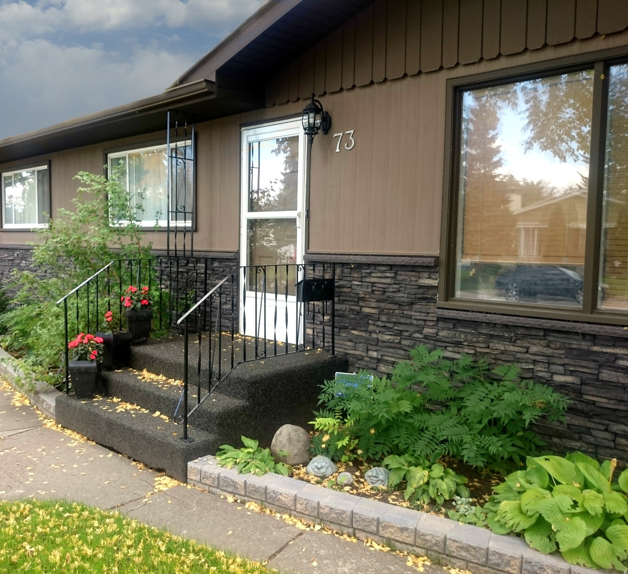 Front elevation siding replacement ecostone products for Eldorado black river stacked stone