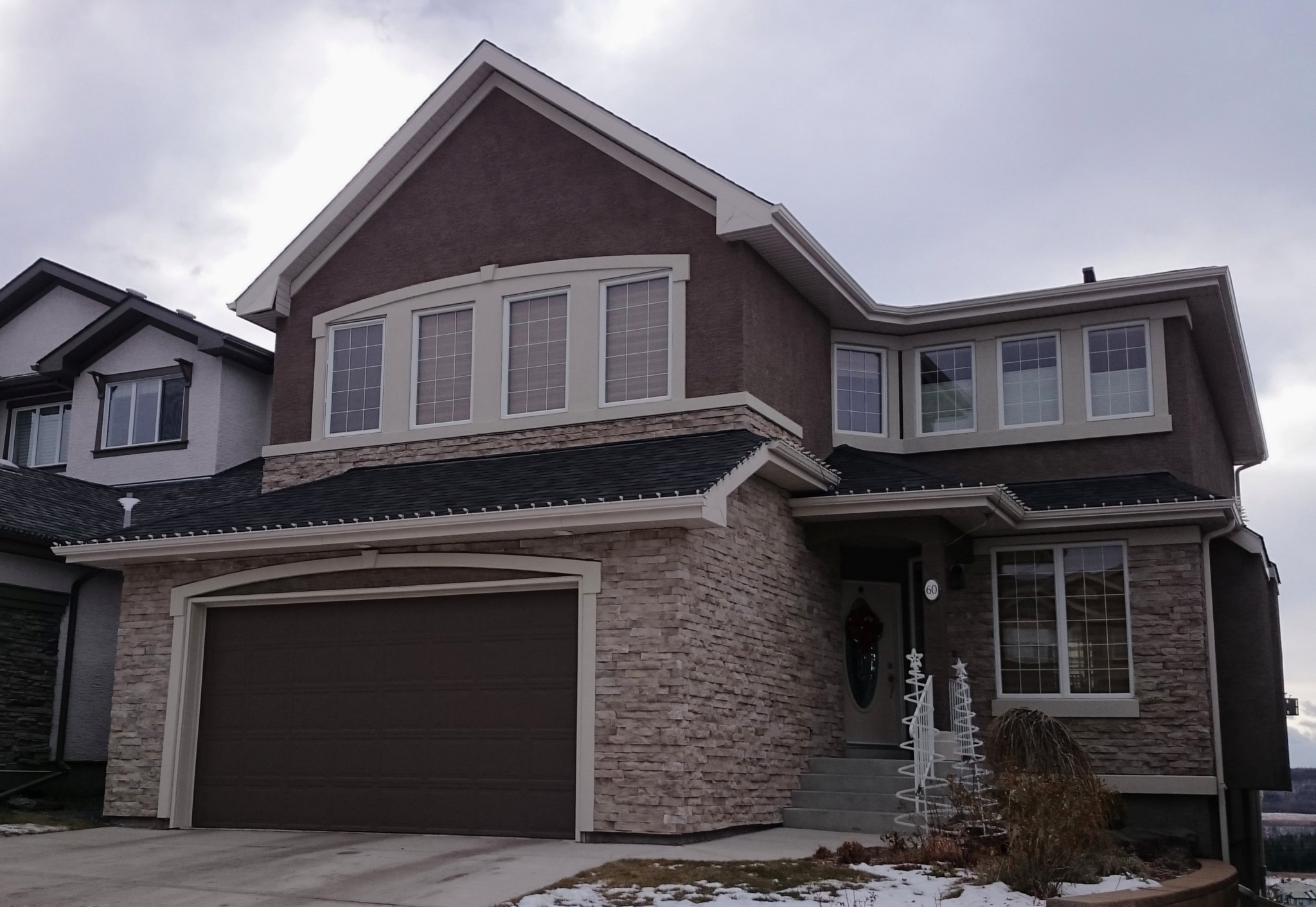 Garage and entrance over stucco ecostone products for How to install stone veneer over stucco